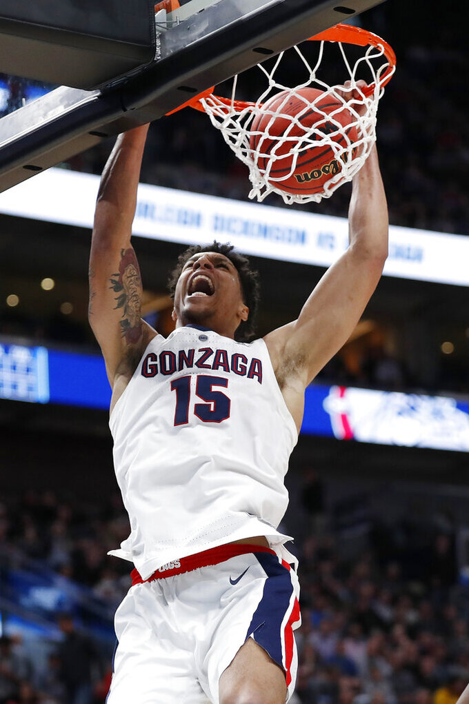 Gonzaga forward Brandon Clarke (15) dunks against Fairleigh Dickinson during the first half of a first-round game in the NCAA men's college basketball tournament Thursday, March 21, 2019, in Salt Lake City. (AP Photo/Jeff Swinger)