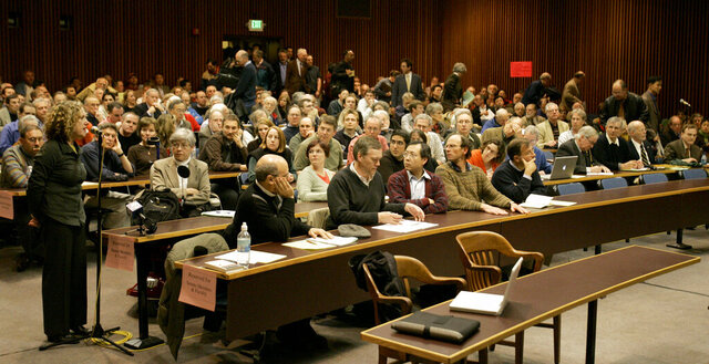 FILE - In this April 19, 2007, file photo, attendees fill the auditorium in Boalt Hall for a debate on the University of California, Berkeley campus in Berkeley, Calif. U.C. Berkeley's prestigious law school has stripped itself of a 19th century namesake who espoused racist views that led to the 1882 Chinese Exclusion Act. John Boalt's name was removed from a main building Thursday, Jan. 30, 2020, after a three-year process. The name removal comes as institutions around the country re-assess the people honored with their monuments, streets and buildings. (AP Photo/Ben Margot, File)
