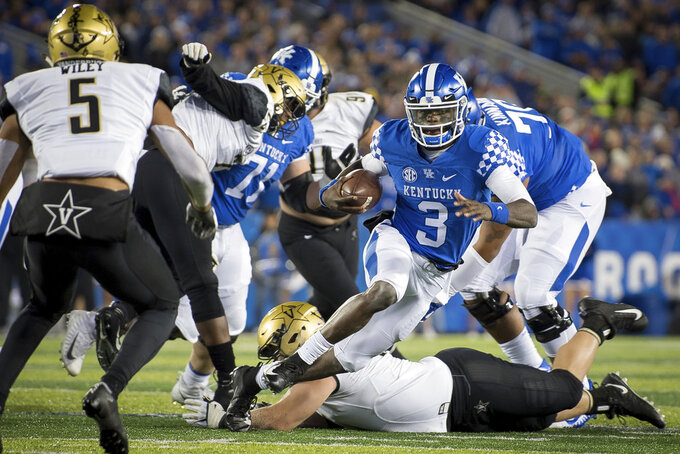 Kentucky quarterback Terry Wilson (3) scrambles with the ball during the first half of an NCAA college football game against Vanderbilt in Lexington, Ky., Saturday, Oct. 20, 2018. (AP Photo/Bryan Woolston)