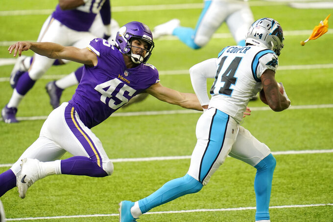 Minnesota Vikings' Troy Dye (45) tries to tackle Carolina Panthers' Pharoh Cooper (14) during a punt return in the first half of an NFL football game, Sunday, Nov. 29, 2020, in Minneapolis. (AP Photo/Jim Mone)