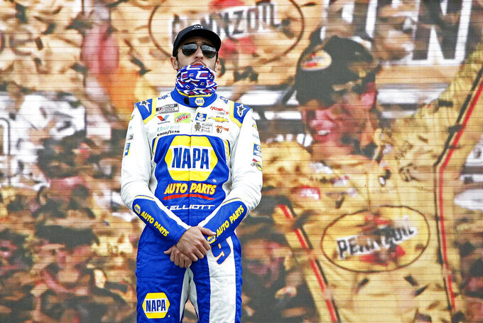 Chase Elliott stands on the Championship 4 stage during driver introductions prior to the NASCAR Cup Series auto race at Phoenix Raceway, Sunday, Nov. 8, 2020, in Avondale, Ariz. (AP Photo/Ralph Freso)