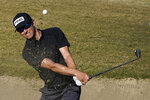 Brandon Hagy hits from the bunker to the 17th green during the first round of The American Express golf tournament on the Nicklaus Tournament Course at PGA West, Thursday, Jan. 21, 2021, in La Quinta, Calif. (AP Photo/Marcio Jose Sanchez)