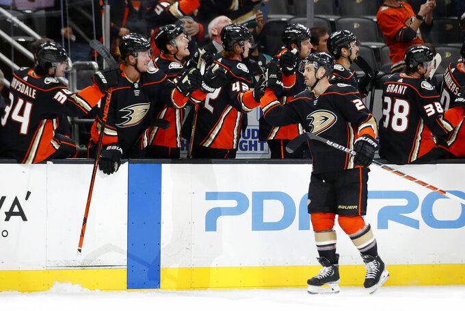 Anaheim Ducks defenseman Kevin Shattenkirk, right, is congratulated after scoring against the Winnipeg Jets during the first period of an NHL hockey game in Anaheim, Calif., Wednesday, Oct. 13, 2021. (AP Photo/Alex Gallardo)