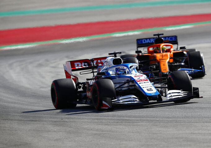Mclaren driver Lando Norris of Britain, right, and Williams driver Nicholas Latifi of Canada steer their cars through a corner during the Formula One pre-season testing session at the Barcelona Catalunya racetrack in Montmelo, outside Barcelona, Spain, Thursday, Feb. 27, 2020. (AP Photo/Joan Monfort)