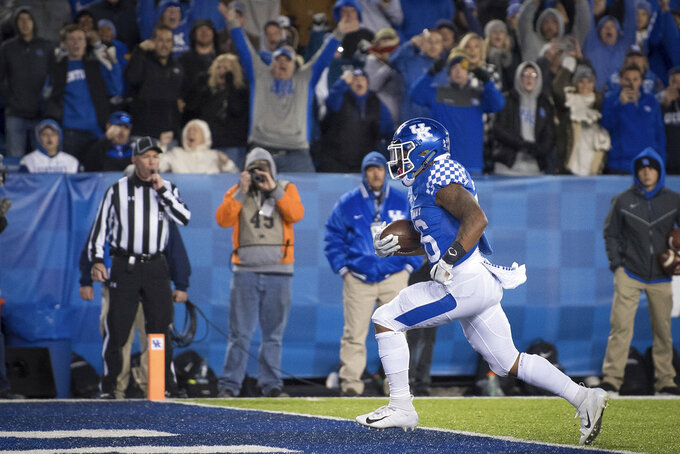 Kentucky running back Benny Snell Jr. (26) runs into the end zone for a touchdown during the second half of an NCAA college football game against Vanderbilt in Lexington, Ky., Saturday, Oct. 20, 2018. Kentucky won, 14-7. (AP Photo/Bryan Woolston)