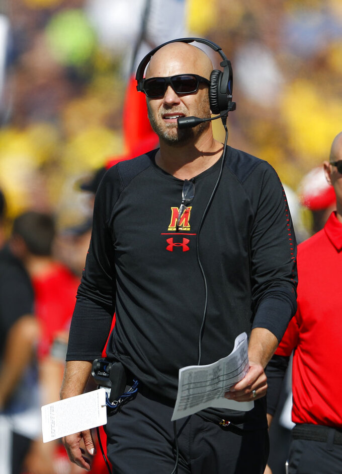 Maryland interim head coach Matt Canada watches in the first half of an NCAA football game against Michigan in Ann Arbor, Mich., Saturday, Oct. 6, 2018. (AP Photo/Paul Sancya)