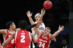 Richmond forward Grant Golden (33) passes as Wisconsin guard Brad Davison (34) tries to block the pass during the first half of an NCAA college basketball game in the Legends Classic, Monday, Nov. 25, 2019, in New York. (AP Photo/Kathy Willens)
