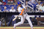 New York Mets' Javier Baez hits solo home run during the eighth inning of a baseball game against the Miami Marlins, Wednesday, Aug. 4, 2021, in Miami. The Mets won 5-3. (AP Photo/Lynne Sladky)
