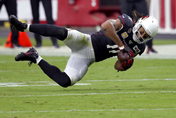 Arizona Cardinals wide receiver Larry Fitzgerald (11) makes a catch against the Atlanta Falcons during the second half of an NFL football game, Sunday, Oct. 13, 2019, in Glendale, Ariz. (AP Photo/Ross D. Franklin)