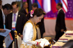 Myanmar leader Aung San Suu Kyi takes her seat during the Association of Southeast Asian Nations (ASEAN) leaders summit plenary session in Bangkok, Thailand, Saturday, June 22, 2019. (AP Photo/Gemunu Amarasinghe)