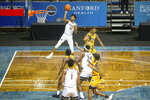West Virginia guard Taz Sherman (12) shoots over a VCU defender during the first half of an NCAA college basketball game Thursday, Nov. 26, 2020, in SIoux Falls, S.D. (AP Photo/Josh Jurgens)