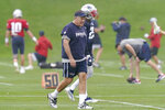 New England Patriots head coach Bill Belichick, front, walks on the field during an NFL football practice, Wednesday, Sept. 22, 2021, in Foxborough, Mass. (AP Photo/Steven Senne)