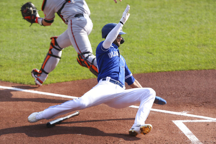 Toronto Blue Jays Lourdes Gurriel Jr. scores on a sacrifice fly by Jonathan Davis during the second inning of a baseball game against the Baltimore Orioles, Sunday, Sept. 27, 2020, in Buffalo, N.Y. (AP Photo/Jeffrey T. Barnes)