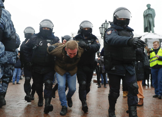 Police detain a man during a protest against the jailing of opposition leader Alexei Navalny in Moscow, Russia, Saturday, Jan. 23, 2021. Russian police are arresting protesters demanding the release of top Russian opposition leader Alexei Navalny at demonstrations in the country's east and larger unsanctioned rallies are expected later Saturday in Moscow and other major cities. (AP Photo/Pavel Golovkin)