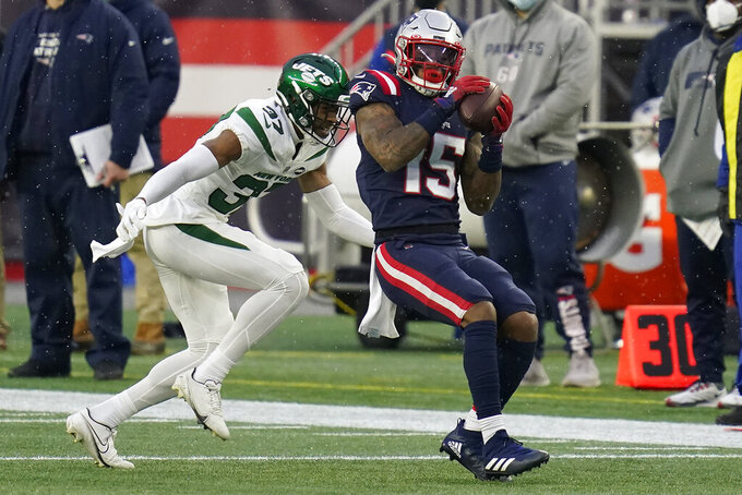 New England Patriots wide receiver N'Keal Harry catches a pass in front of New York Jets cornerback Bryce Hall in the second half of an NFL football game, Sunday, Jan. 3, 2021, in Foxborough, Mass. (AP Photo/Charles Krupa)