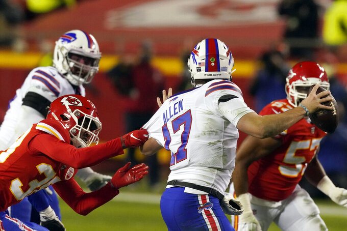 Buffalo Bills quarterback Josh Allen (17) is sacked by Kansas City Chiefs safety L'Jarius Sneed, left, during the first half of the AFC championship NFL football game, Sunday, Jan. 24, 2021, in Kansas City, Mo. (AP Photo/Charlie Riedel)