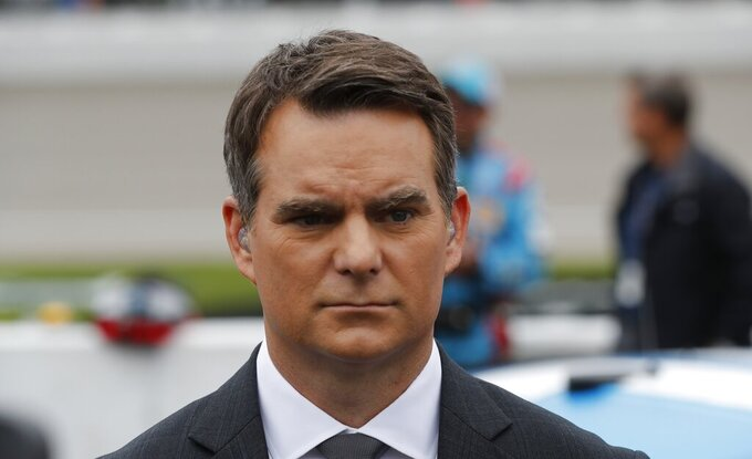Fox Sports broadcaster Jeff Gordon on pit row before the NASCAR cup series auto race at Michigan International Speedway, Sunday, June 9, 2019, in Brooklyn, Mich. (AP Photo/Carlos Osorio)