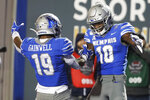 Memphis wide receiver Damonte Coxie (10) celebrates with running back Kenneth Gainwell (19) after Coxie caught a 49-yard touchdown pass against SMU during the second half of an NCAA college football game Saturday, Nov. 2, 2019, in Memphis, Tenn. Memphis won 54-48. (AP Photo/Mark Humphrey)