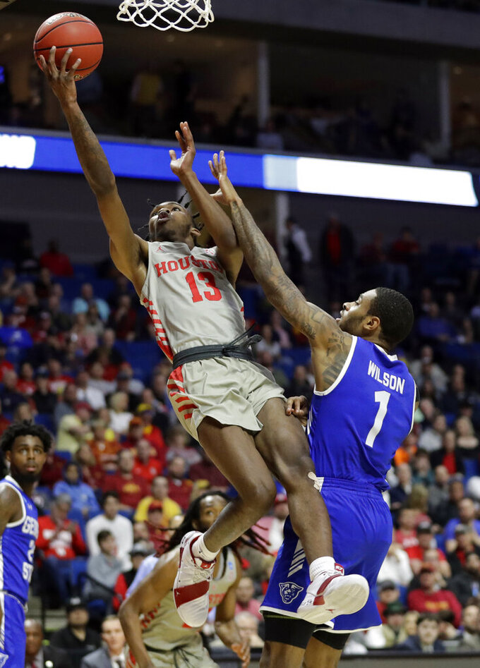 Houston's DeJon Jarreau (13) shoots over Georgia State's Damon Wilson (1) during the second half of a first round men's college basketball game in the NCAA Tournament Friday, March 22, 2019, in Tulsa, Okla. (AP Photo/Jeff Roberson)