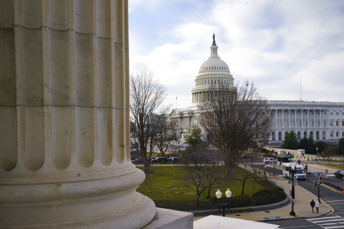The Capitol is seen as defense arguments by the Republicans resume in the impeachment trial of President Donald Trump on charges of abuse of power and obstruction of Congress, in Washington, Monday, Jan. 27, 2020. (AP Photo/J. Scott Applewhite)