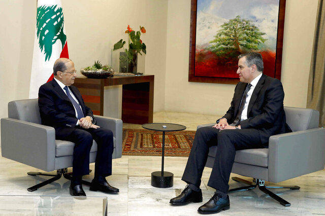 In this photo released by Lebanon's official government photographer Dalati Nohra, Lebanese President Michel Aoun, left, meets with Prime Minister-Designate Mustapha Adib, at the presidential palace, in Baabda, east of Beirut, Lebanon, Monday, Sept. 14, 2020. Lebanese officials are holding eleventh-hour negotiations over the formation of a new government, a process which hit snags over the weekend despite a looming deadline to deliver on a promise made to French President Emmanuel Macron. (Dalati Nohra via AP)