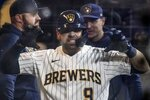 Milwaukee Brewers' Manny Pina reacts after hitting a home run during the eighth inning of a baseball game against the Chicago Cubs Saturday, Sept. 18, 2021, in Milwaukee. (AP Photo/Morry Gash)