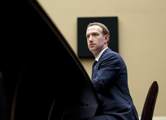 In this April 11, 2018, photo, Facebook CEO Mark Zuckerberg listens to a question as he testifies before a House Energy and Commerce hearing on Capitol Hill in Washington. Facebook is rebuffing efforts by U.S. Attorney General William Barr to give authorities a way to read encrypted messages. The heads of Facebook-owned WhatsApp and Messenger services told Barr and his U.K. and Australian counterparts that Facebook is moving forward with plans to enable end-to-end encryption on all of its messaging services. End-to-end encryption locks up messages so that not even Facebook can read their contents.  (AP Photo/Andrew Harnik, File)