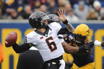 Oklahoma State quarterback Dru Brown throws during their NCAA college football game against West Virginia  in Morgantown, W.Va., on Saturday, Nov. 23, 2019. (AP Photo/Chris Jackson)