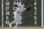 New York Yankees' Joey Gallo misses the catch on a fly ball hit by Boston Red Sox's Kyle Schwarber allowing Alex Verdugo to score during the seventh inning of a baseball game, Sunday, Sept. 26, 2021, in Boston. (AP Photo/Michael Dwyer)
