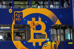 FILE - This May 12, 2021, file photo shows an advertisement for the cryptocurrency Bitcoin displayed on a tram in Hong Kong. Bitcoin is one of several cryptocurrencies that radical right provocateurs, banned by traditional financial institutions, are using to raise significant amounts of money and move it around the world. (AP Photo/Kin Cheung, File)