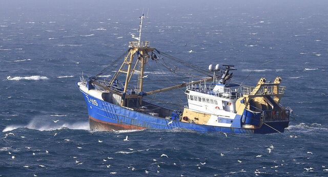 A fishing boat at work in the English Channel, off the southern coast of England, Saturday Feb. 1, 2020. The fishing industry if one of the main subjects for negotiations, after the UK left the European Union on Friday, ending 47 years of close and sometimes uncomfortable ties to Brussels. (Gareth Fuller/PA via AP)