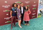 """Cast members of the new FX on Hulu series """"Reservation Dogs"""" pose for a photo with the co-creator of the series, Oklahoma filmmaker Sterlin Harjo, on Monday, Aug. 2, 2021, outside the Circle Cinema in Tulsa, Oka.. Pictured, from left, are D'Pharaoh Woon-A-Tai, Pauline Alexis, Harjo and Devery Jacobs. Photo by Sean Murphy. (AP Photo/Sean Murphy)"""