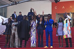 Writer director Mati Diop, fifth from left, poses with cast and crew upon arrival at the premiere of the film 'Atlantique' at the 72nd international film festival, Cannes, southern France, Thursday, May 16, 2019. (AP Photo/Petros Giannakouris)