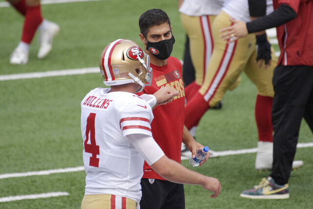 San Francisco 49ers quarterback Jimmy Garoppolo, right, greets quarterback Nick Mullens during warm-ups before an NFL football game against the New York Giants, Sunday, Sept. 27, 2020, in East Rutherford, N.J. (AP Photo/Bill Kostroun)