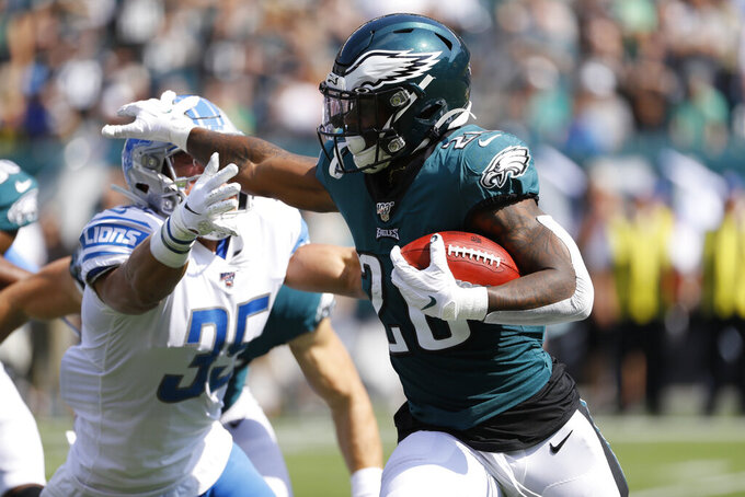 Philadelphia Eagles' Miles Sanders, right, returns a kick past Detroit Lions' Miles Killebrew during the first half of an NFL football game, Sunday, Sept. 22, 2019, in Philadelphia. (AP Photo/Michael Perez)