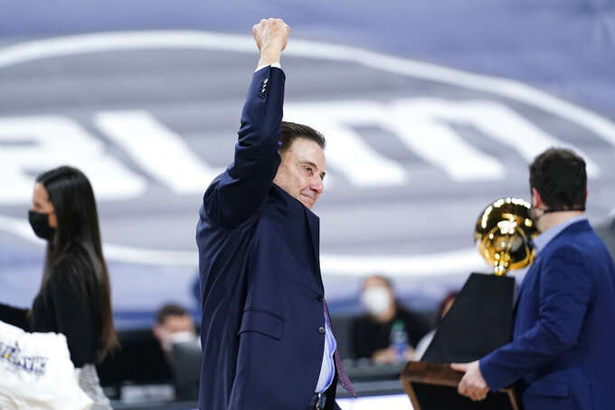 Iona head coach Rick Pitino celebrates after winning an NCAA college basketball game against Fairfield during the finals of the Metro Atlantic Athletic Conference tournament, Saturday, March 13, 2021, in Atlantic City, N.J. (AP Photo/Matt Slocum)
