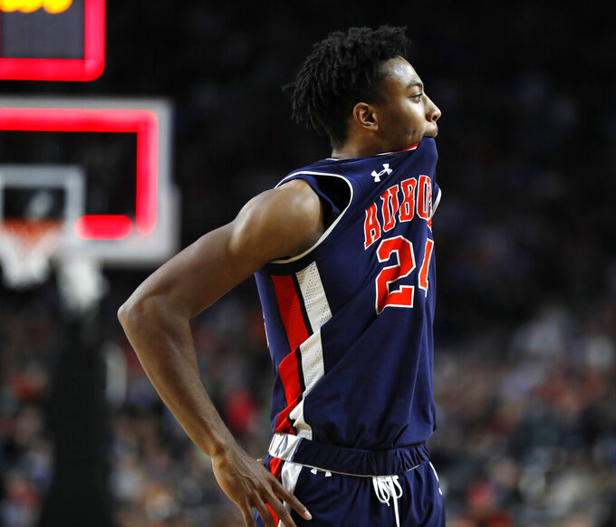 Auburn forward Anfernee McLemore reacts at the end of a semifinal round game against Virginia in the Final Four NCAA college basketball tournament, Saturday, April 6, 2019, in Minneapolis. (AP Photo/Charlie Neibergall)
