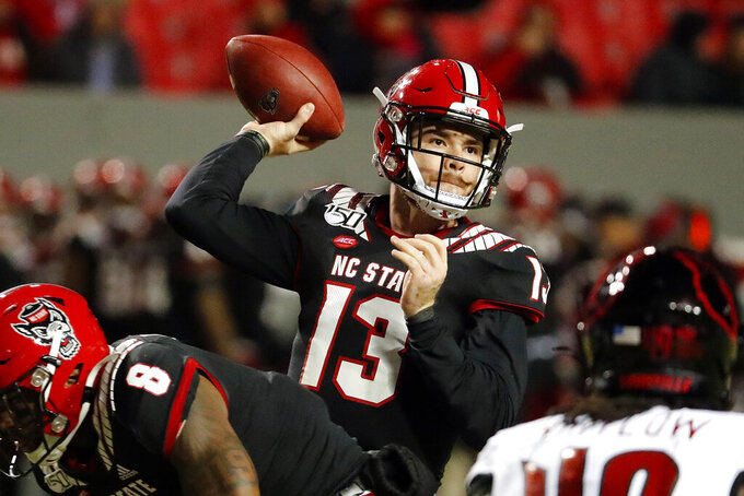 FILE - In this Nov. 16, 2019, file photo, North Carolina State's Devin Leary (13) passes the ball against Louisville during the first half of an NCAA college football game in Raleigh, N.C. The Wolfpack will try to regroup after winning just four games last season. (AP Photo/Karl B DeBlaker, File)
