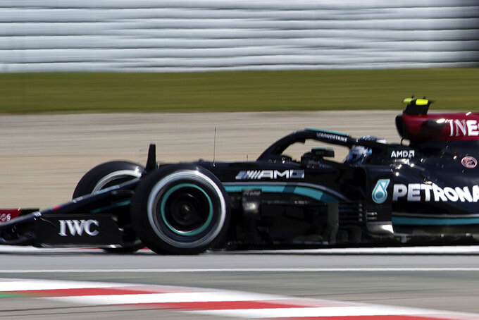 Mercedes driver Valtteri Bottas of Finland steers his car during the first free practice for the Spanish Formula One Grand Prix at the Barcelona Catalunya racetrack in Montmelo, just outside Barcelona, Spain, Friday, May 7, 2021. The Spanish Grand Prix will be held on Sunday. (AP Photo/Emilio Morenatti)