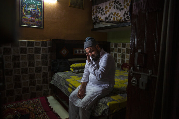 Haroon, who saw his 32 year-old brother being shot and killed by his Hindu neighbors during the February 2020 communal riots, breaks down while speaking to Associated Press inside his home in North Ghonda, one of the worst riot affected neighborhood, in New Delhi, India, Friday, Feb. 19, 2021. As the first anniversary of bloody communal riots that convulsed the Indian capital approaches, Muslim victims are still shaken and struggling to make sense of their struggle to seek justice. (AP Photo/Altaf Qadri)