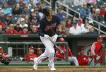 Cleveland Indians' Ryan Flaherty watches the flight of his home run against the Cincinnati Reds during the third inning of a spring training baseball game Monday, March 11, 2019, in Goodyear, Ariz. (AP Photo/Ross D. Franklin)