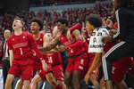 The Louisville bench celebrates a play during the second half of an NCAA college basketball game against Virginia Tech, Sunday, March 1, 2020 in Louisville, Ky. (AP Photo/Bryan Woolston)
