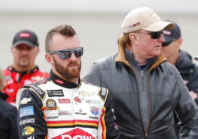 Ty Dillon stands with grandfather Richard Childress at the NASCAR cup series auto race at Michigan International Speedway, Monday, June 10, 2019, in Brooklyn, Mich. (AP Photo/Carlos Osorio)