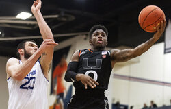 FILE - In this Sunday, Nov. 25, 2018, file photo, Miami guard Chris Lykes, right, goes to the basket past Seton Hall forward Sandro Mamukelashvili during the second half of an NCAA college basketball final game at the Wooden Legacy tournament in Fullerton, Calif. Lykes, the Miami Hurricanes' 5-foot-7 dynamo, has become one of the leading scorers in the Atlantic Coast Conference. (AP Photo/Kyusung Gong, File)