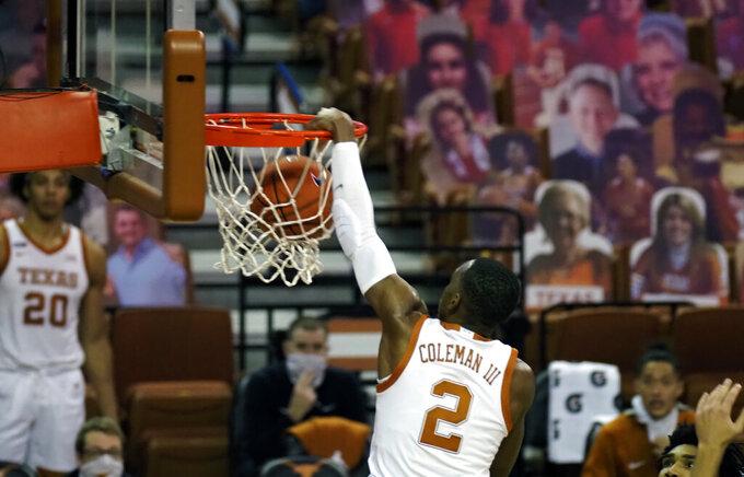Texas guard Matt Coleman dunks the ball during the second half of an NCAA college basketball game against Villanova, Sunday, Dec. 6, 2020, in Austin, Texas. Villanova won 68-64. (AP Photo/Michael Thomas)