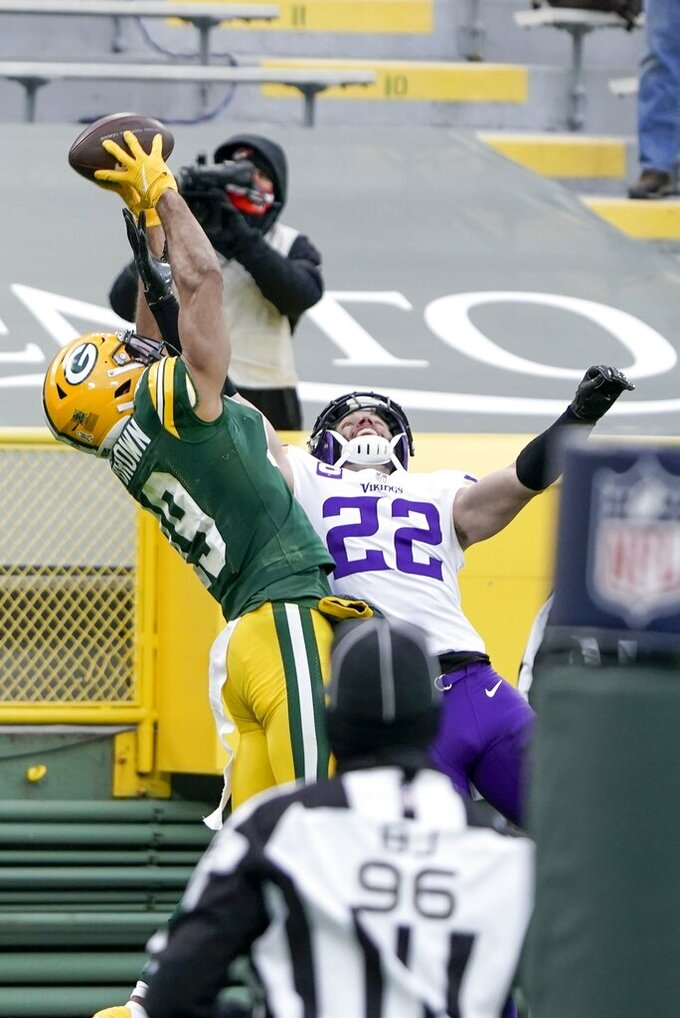 Green Bay Packers' Equanimeous St. Brown can't catch a pass with Minnesota Vikings' Harrison Smith defending during the second half of an NFL football game Sunday, Nov. 1, 2020, in Green Bay, Wis. (AP Photo/Morry Gash)
