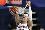 FILE - Gonzaga forward Corey Kispert dunks during the second half of an NCAA college basketball game against BYU in Spokane, Wash., in this Thursday, Jan. 7, 2021, file photo. Kispert has made The Associated Press All-America first team, announced Tuesday, March 16, 2021.(AP Photo/Young Kwak, File)