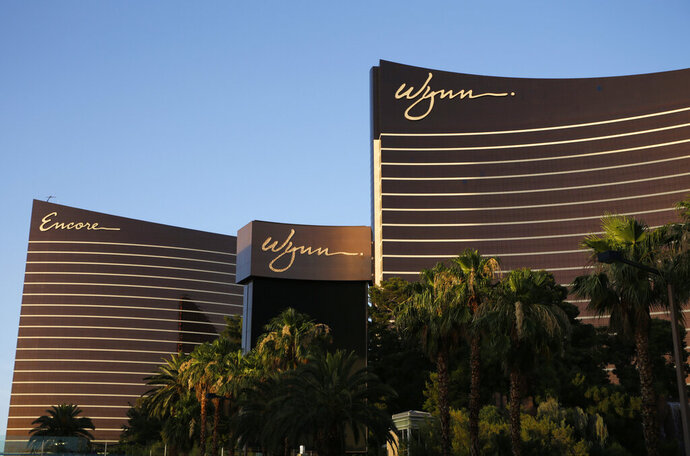 FILE - This June 17, 2014, file photo shows the Wynn Las Vegas and Encore resorts in Las Vegas, both owned and operated by Wynn Resorts. One Las Vegas Strip casino owner says it tallied 548 positive tests for COVID-19 among its 12,000 employees since May 2020. Wynn Resorts reported Thursday, Sept. 17, 2020, that it had 497 positive tests for the new coronavirus since reopening June 4, 2020, after identifying 51 in initial screenings. (AP Photo/John Locher, File)