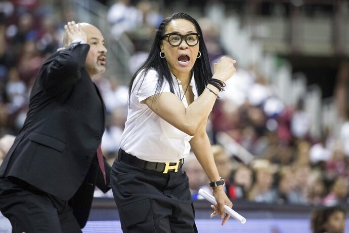 FILE - In this March 3, 2019, file photo, South Carolina head coach Dawn Staley, right, communicates with players during the first half of an NCAA college basketball game against Mississippi State, in Columbia, S.C. Staley, fresh off a dominating U.S. run to the gold at the FIBA AmeriCup tournament, switches focus to her day job in preparing a young South Carolina team to stay competitive nationally and in the Southeastern Conference.(AP Photo/Sean Rayford, File)