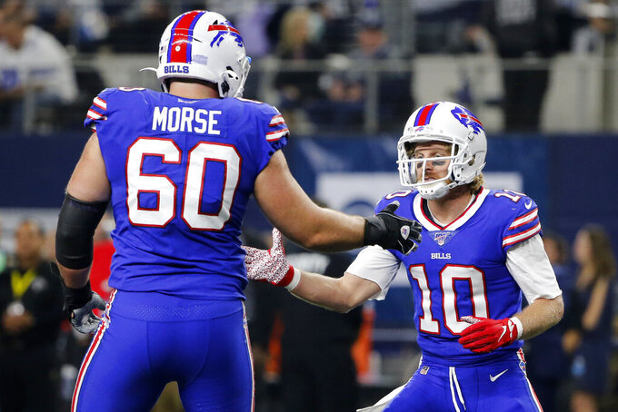Buffalo Bills center Mitch Morse (60) and wide receiver Cole Beasley (10) celebrate a touchdown scored by Beasley in the first half of an NFL football game against the Dallas Cowboys in Arlington, Texas, Thursday, Nov. 28, 2019. (AP Photo/Michael Ainsworth)